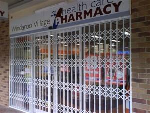 Trellidor-Retractable-Security-Trellis-Windaroo-Pharmacy-closed